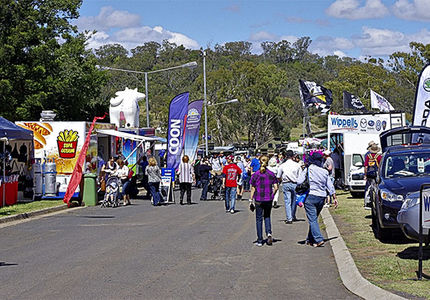 Street with pop-up stalls and people at Heritage Bank Toowoomba Royal Show